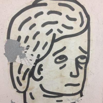 """""""Un homme triste."""" Peinture sur papier, artiste et année de productions inconnus. L'homme triste peut s'observer sur l'un des murs au haut du passage """"Arlaud"""", qui relie la Riponne au théâtre Boulimie."""